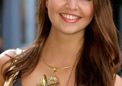 Young lady wears an artistic brass necklace with precious stones designed by Danpae jewelry